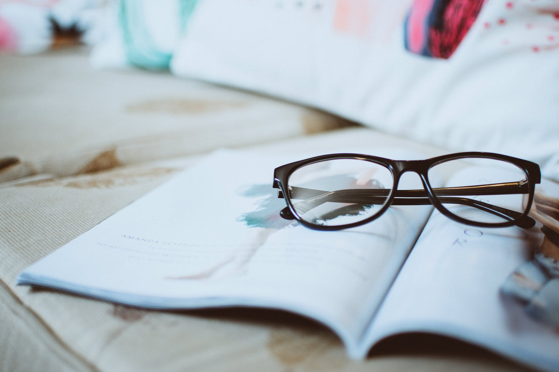 black framed eyeglasses on paper